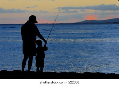 Father and son fishing just after sunset.