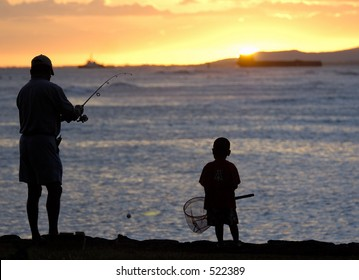 Father and son fishing just at sunset.
