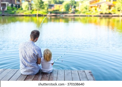 Father and son fishing on the pier