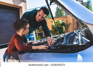 The father and son fixing the car