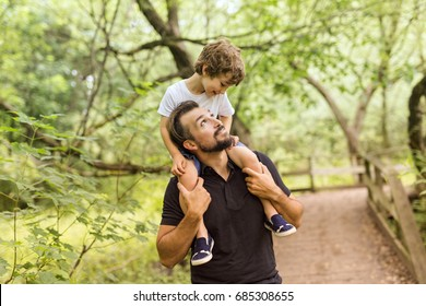 A Father and son in forest on a meadow