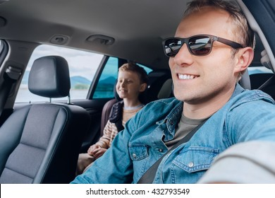 Father with son go in car