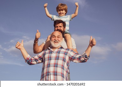 Father son and grandfather playing - family time together. Boy with father and grandfather. Male multi generation portrait. Three men generation