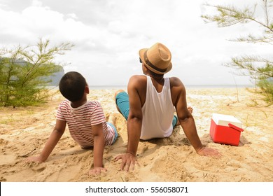 Father and son are happy for picnic on the beach.Zoom in