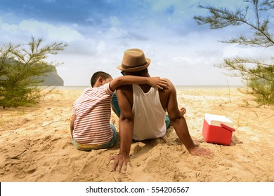 Father and son are happy for picnic with sea view.Zoom in201
