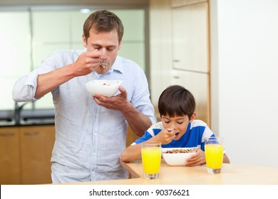 Father and son having cereals together