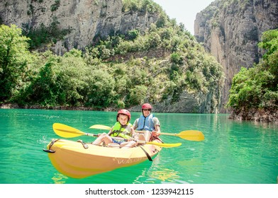 Father and son having fun and enjoying sports outdoors. Team outdoor activities. Family Kayaking . Mont-rebei gorge ( Congost de Mont-rebei) Lleida. Spain