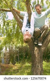 Father and son having fun on tree