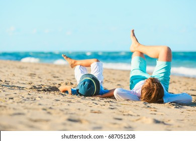 father and son having fun on beach