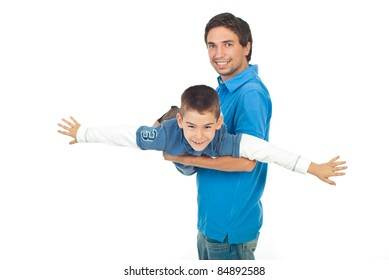 Father and son having fun and playing together aeroplane isolated on white background