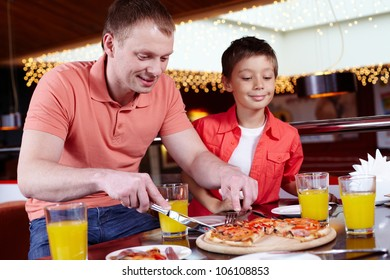 Father and son having a party for men only at the pizzeria