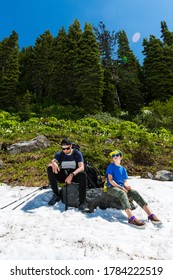 Father and son hiking at Cascade mountains, Mt. Rainier National Park