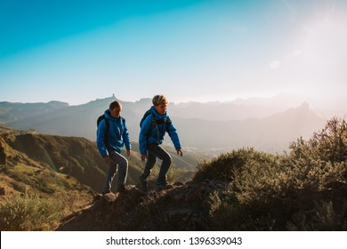 father and son hiking in scenic mountains