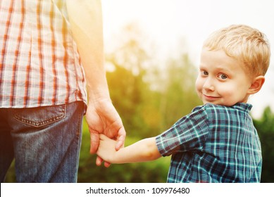 Father and son holding hand in hand
