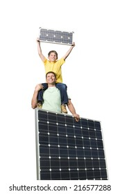 Father and son holding solar panels