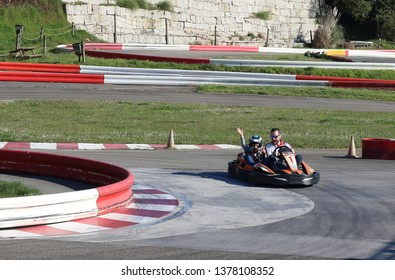 father and son in a kart circuit