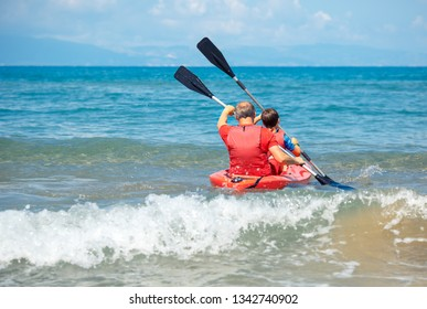 Father and son kayaking in ocean. Active vacation with young kid. Holiday activity with schoolboy child. Family summer fun