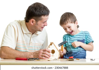 Father and son kid working with hammer