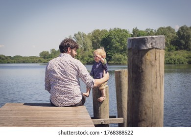 father and son at the lake