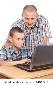 Father and son at the laptop, isolated on white background