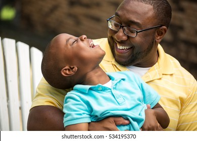 Father and son laughing.