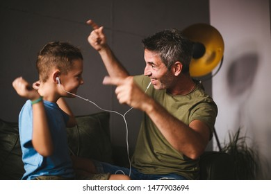 Father and son listening music