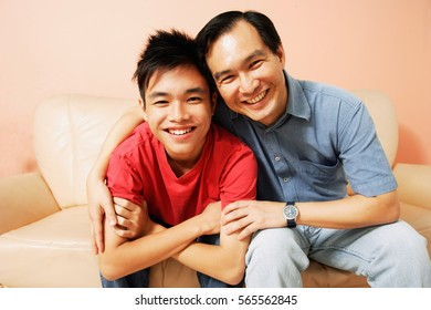 Father and son looking at camera, portrait
