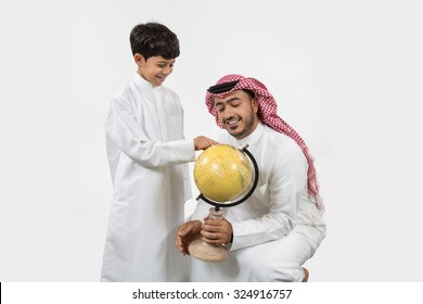 Father with son looking at globe