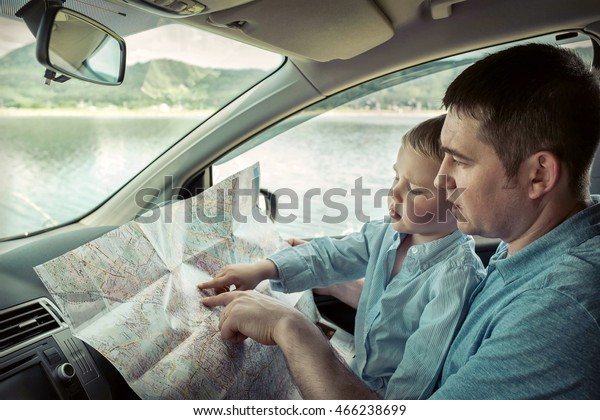 Father Son Looking On Map Car Stock Photo (Edit Now) 466238699 on navigation in car, water in car, time in car, entertainment in car,