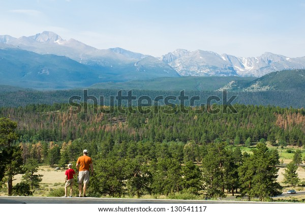 """Father and son looking at the valley in the National Park """"Rocky Mountains"""", Colorado"""