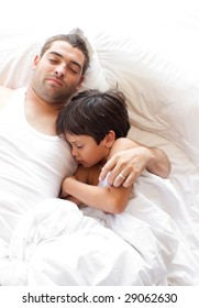 Father and Son Lying on bed having fun