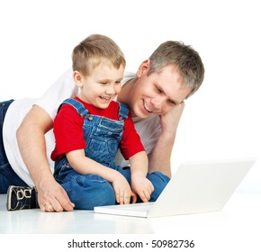 Father and son lying on the floor with notebook