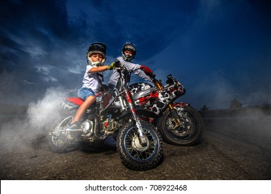 Father and son motorcycle bikers. Bikers family dressed in protective suit and helmet.
