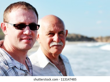 father and son on a beach