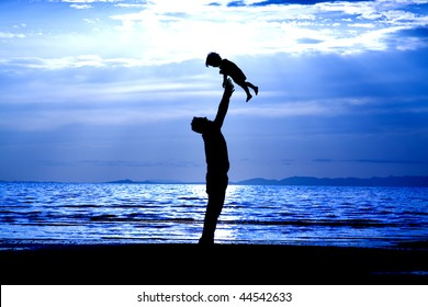 Father and son on the Beach - Silhouette Shot
