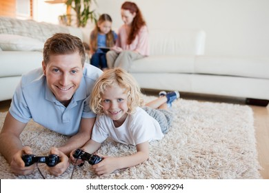 Father and son on the floor playing video games together