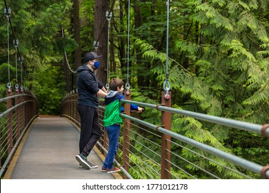 A father and a son on a hike in a park during coronavirus pandemic