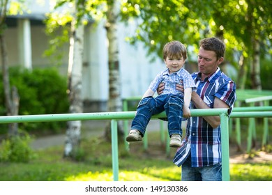 Father and son on the playground