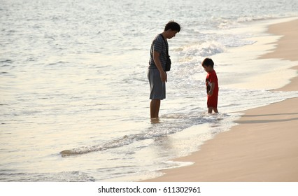 Father and son on sandy beach in holiday at PMY. beach rayong Thailand,February 17,2017,17:30 pm