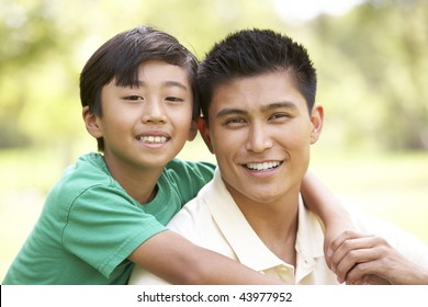 Father And Son In Park