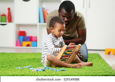 Father and son paying in the children room