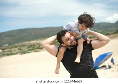 Father and son playing in the beach