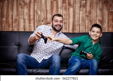 father and son playing in the console, a family vacation, the concept of family values and the modern-day game