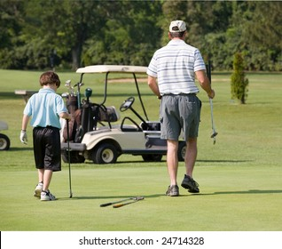 Father and Son Playing Golf