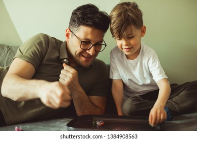 Father and son playing marbles