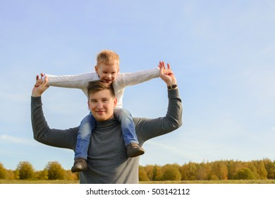 Father and son playing outdoors together.