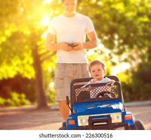 Father with son playing with toy car