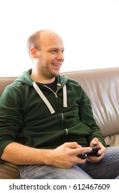 Father and son playing video games, making different facial expressions during competitive gaming, celebrating, fighting, congratulating.