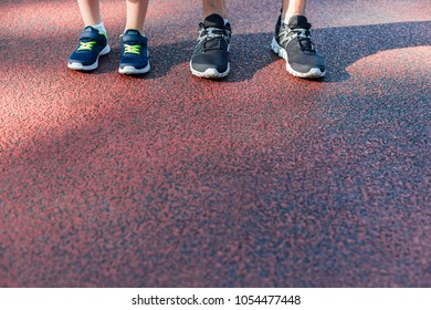 Father and son preparing to run with copy space