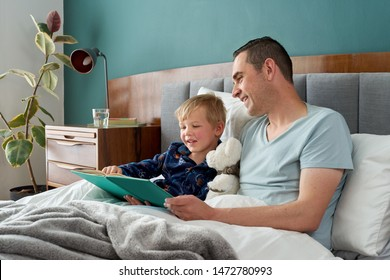 Father and son reading a book in bed, bedtime stories daily routine habit